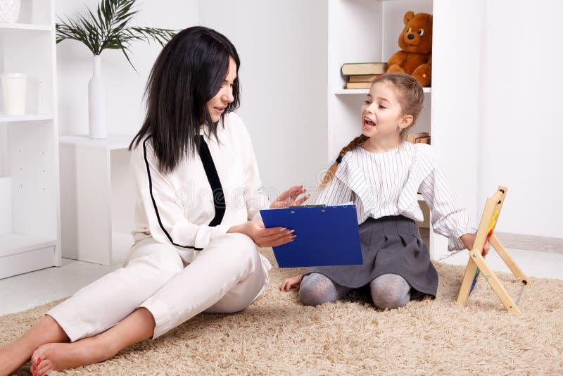 Children psyhology concept. Session of psychologist treatment. stock photo