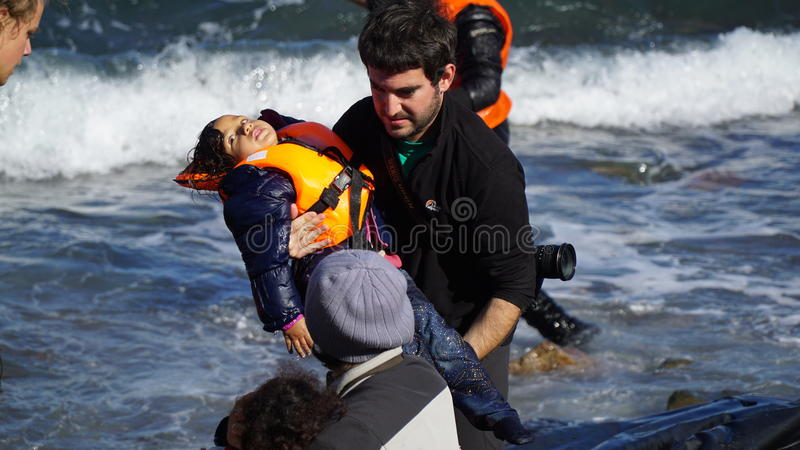 Children are pulled out of the boat. stock photos