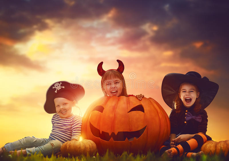 Children and pumpkins on Halloween stock photography