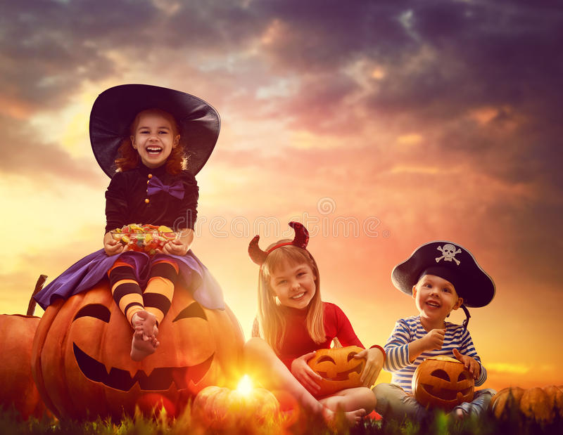 Children and pumpkins on Halloween royalty free stock photo