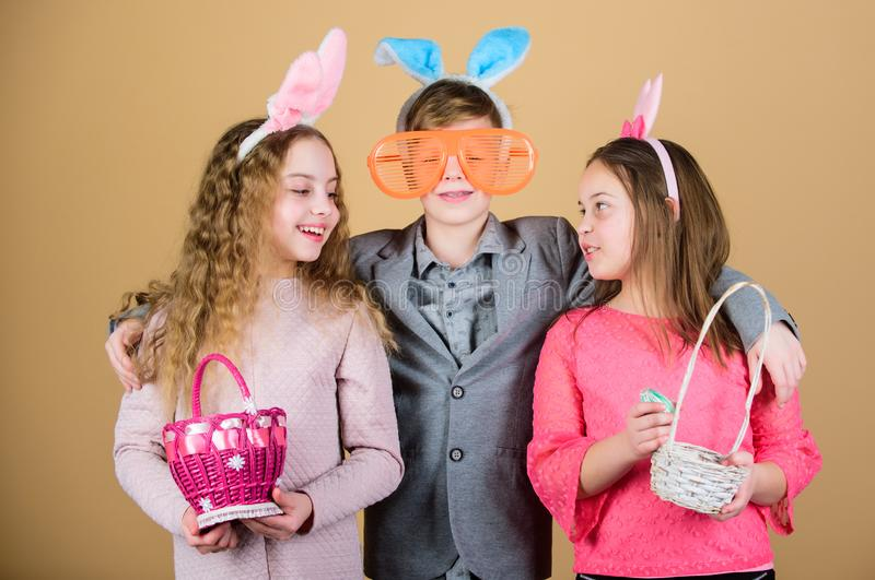 Children in rabbit bunny ears. Happy easter. Spring holiday party. Egg hunt. Family and sisterhood. Little girls and boy royalty free stock photos