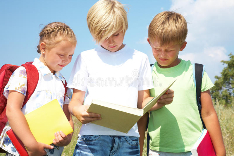 Children read a book stock image