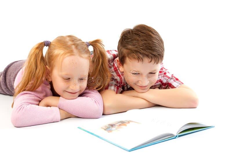 Children reading stock photography