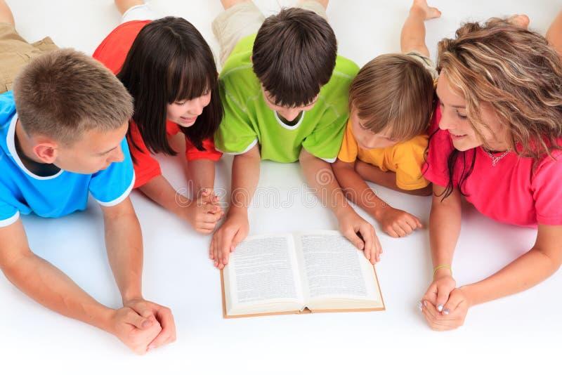 Children reading book royalty free stock photo