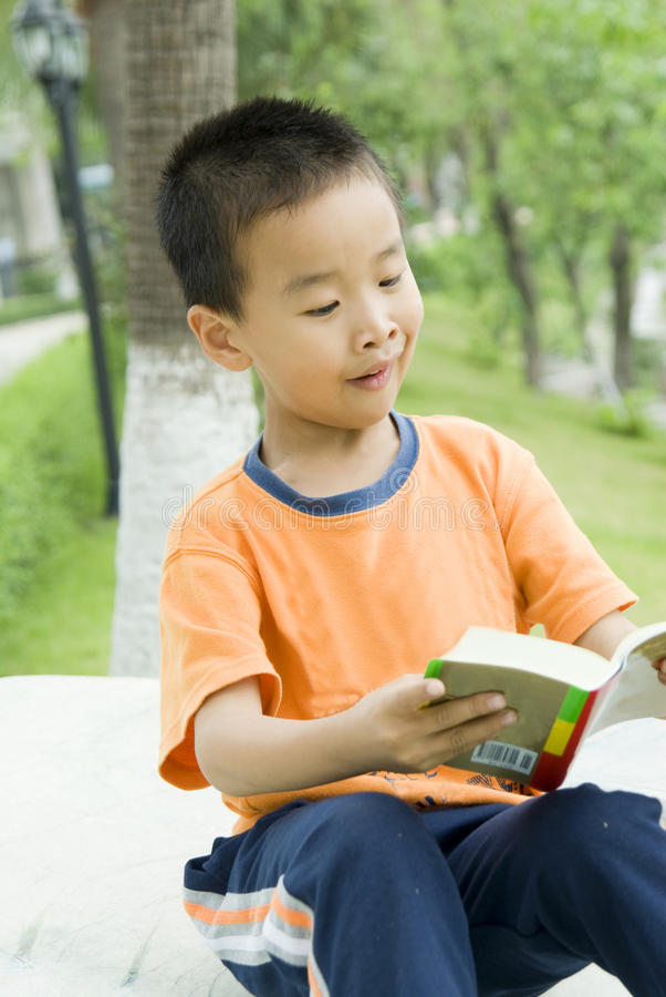 A children reading book royalty free stock photo