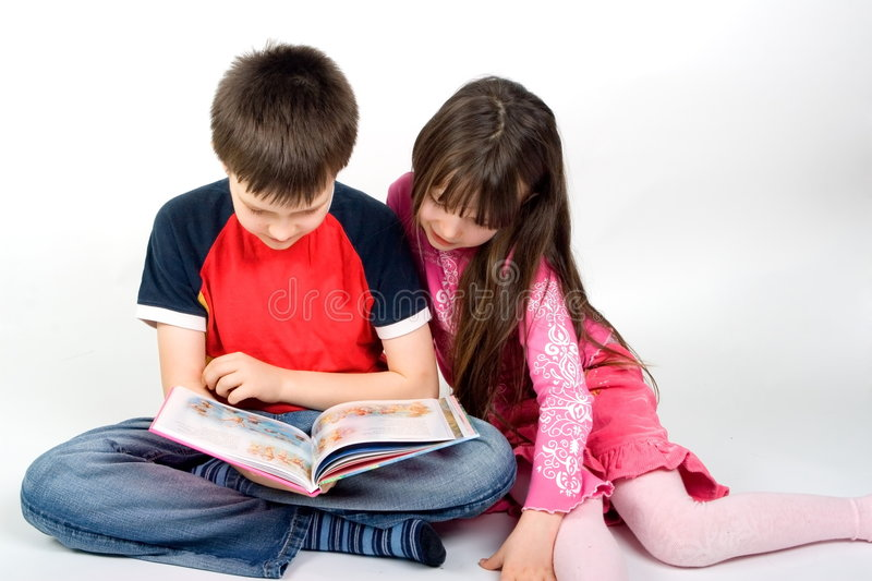 Children Reading a Book royalty free stock photography