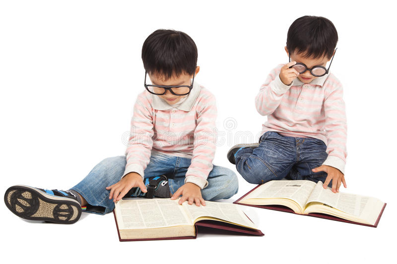 Children reading book. On the floor and isolated on white stock images