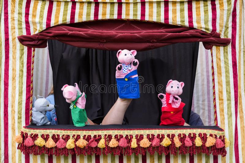 Story of the three little pigs and the big bad wolf with hand puppets royalty free stock image
