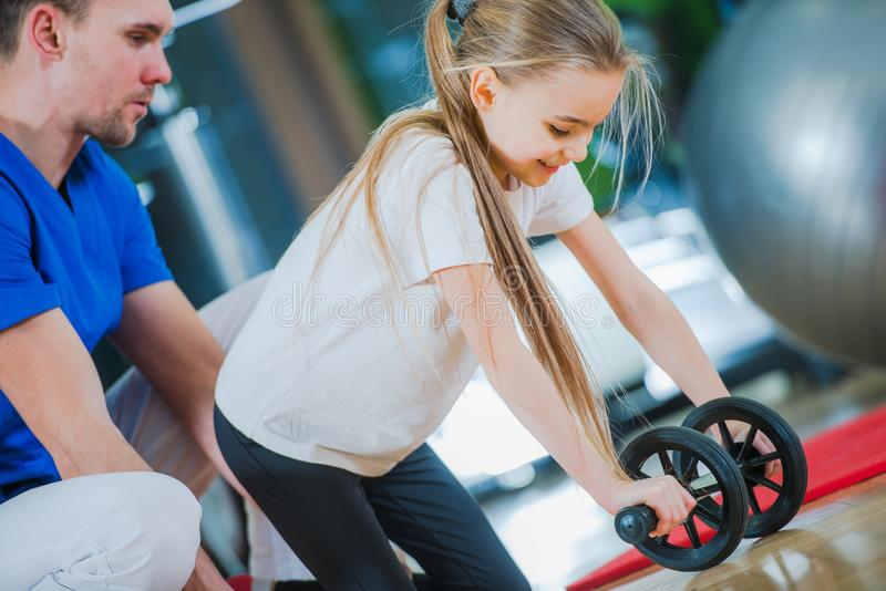 Children Rehabilitation Center. Little Girl Exercise with Medical Practitioner royalty free stock photography