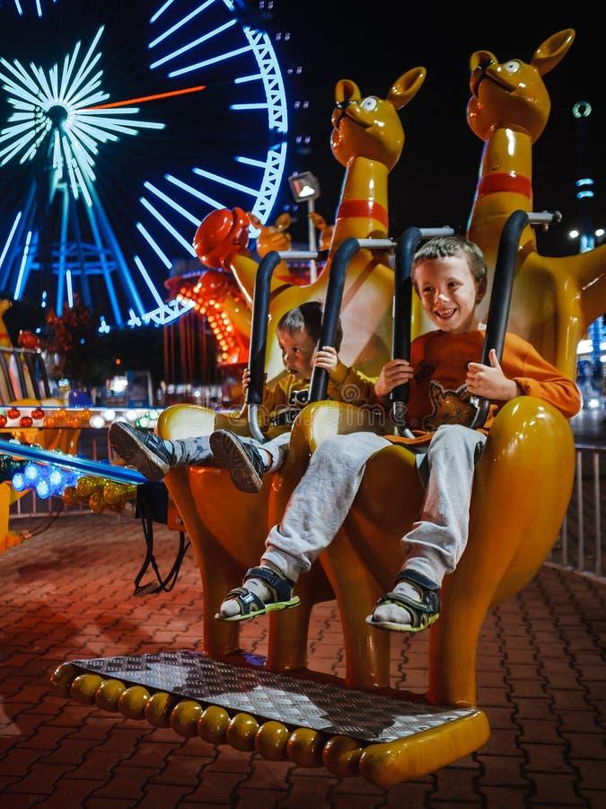 Children ride in an amusement park royalty free stock photos