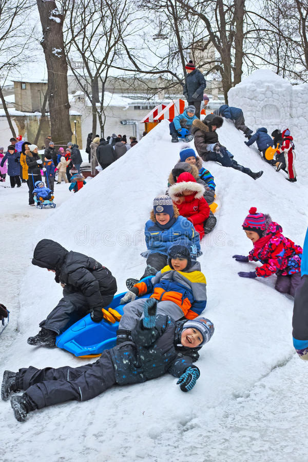 Free Children Ride With A Snow Slide Royalty Free Stock Image - 50296346