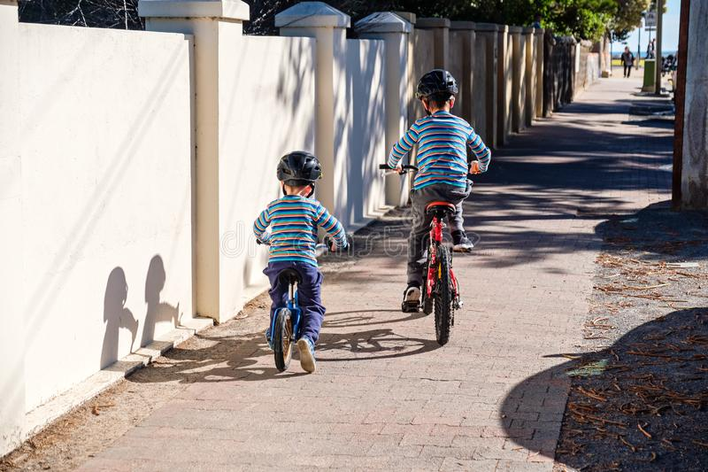 Children riding bicycles in Glenelg stock photography