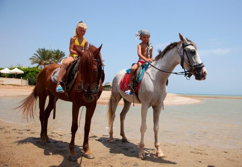 Children riding royalty free stock image