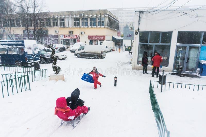 Children riding sleighs in Bucharest royalty free stock photos