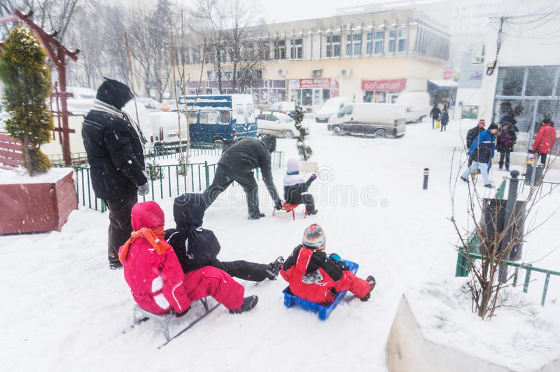 Children riding sleighs in Bucharest royalty free stock photo