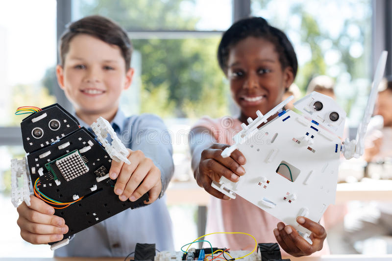 Children with robot models smiling at the camera stock images
