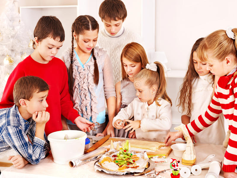 Download Children Rolling Dough In Kitchen. Stock Image - Image: 27677409
