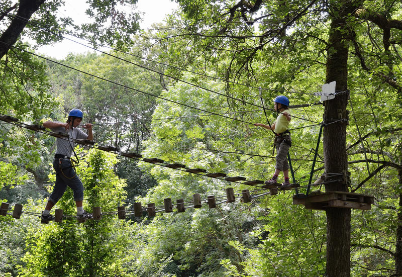 Children at the ropes course stock image