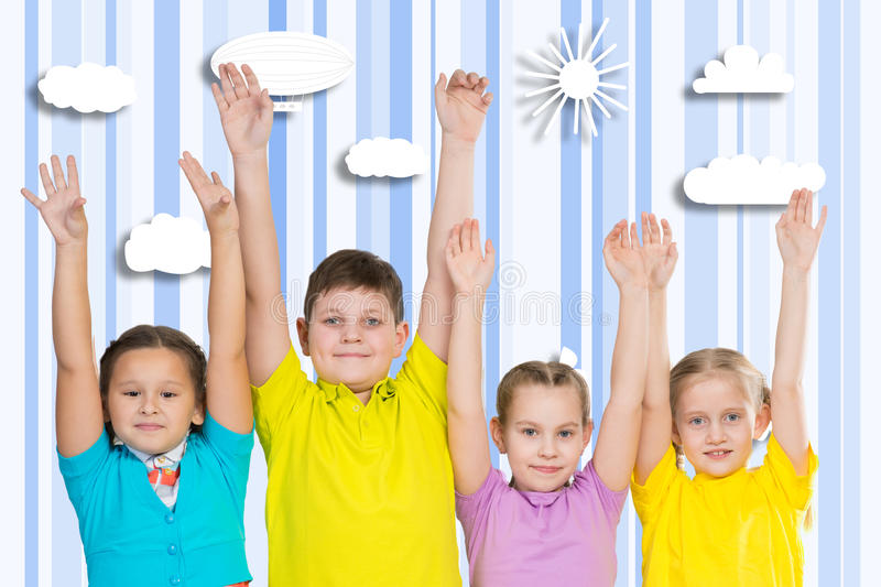 Children in a row stock images