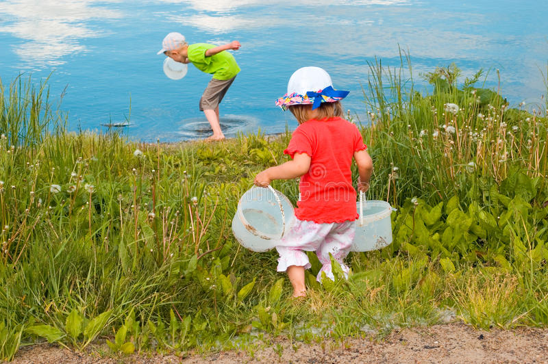 Children run for water stock photography