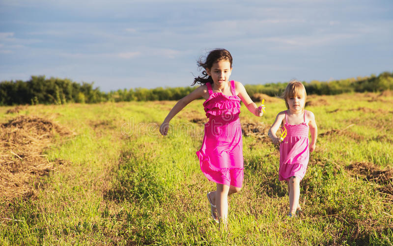 Girls Running In Countryside Royalty Free Stock Image