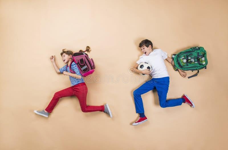 Children running to school royalty free stock image