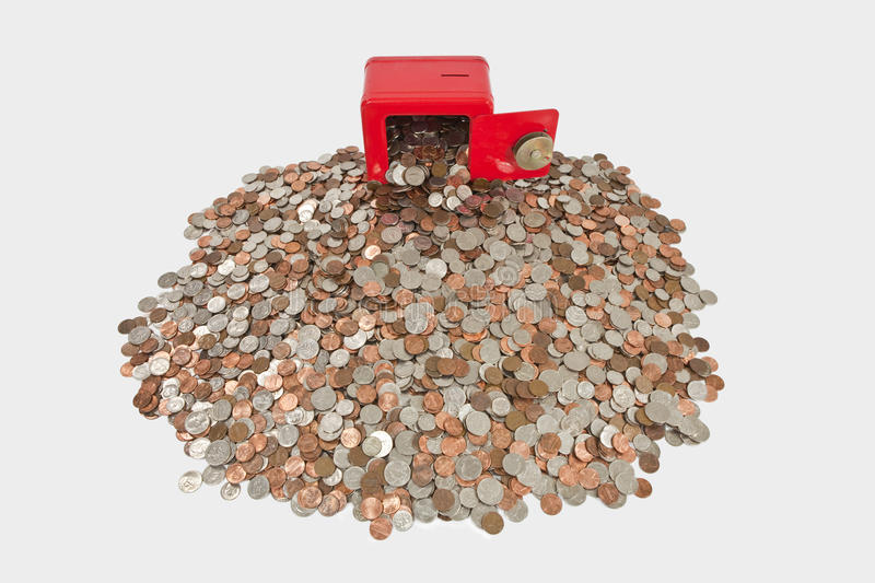 Children's Bank with Giant Pile of Coins.  stock images