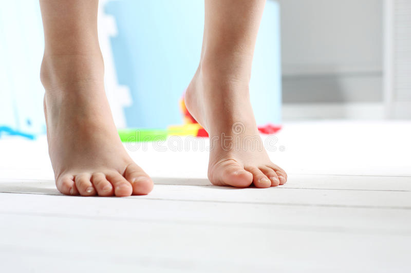 Children's bare feet royalty free stock photography