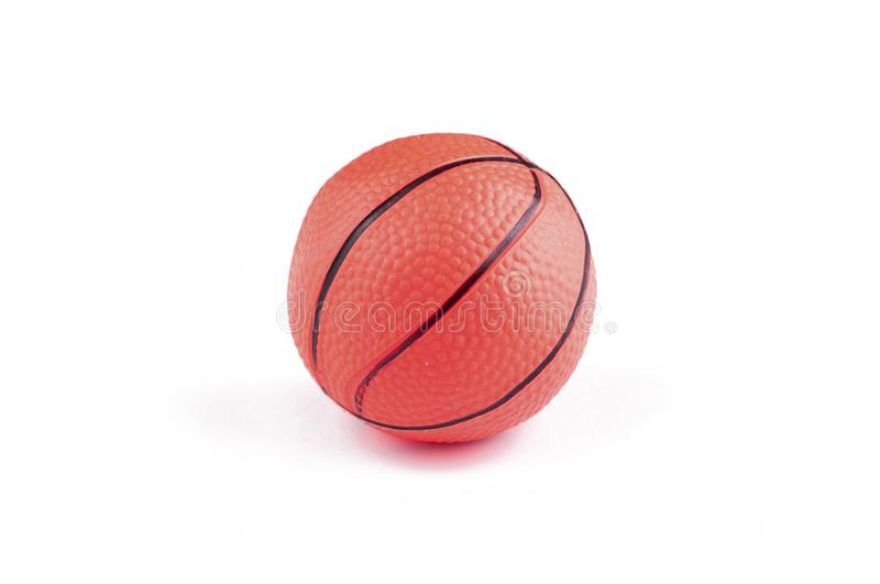 Children's basketball ball isolated on a white background.Copy space. Play textured rubber closeup object game sphere orange sport studio symbol royalty free stock image