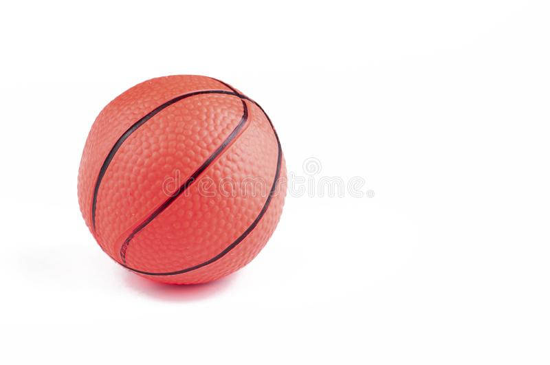 Children's basketball ball isolated on a white background.Copy space. Play textured rubber closeup object game sphere orange sport studio symbol royalty free stock photography