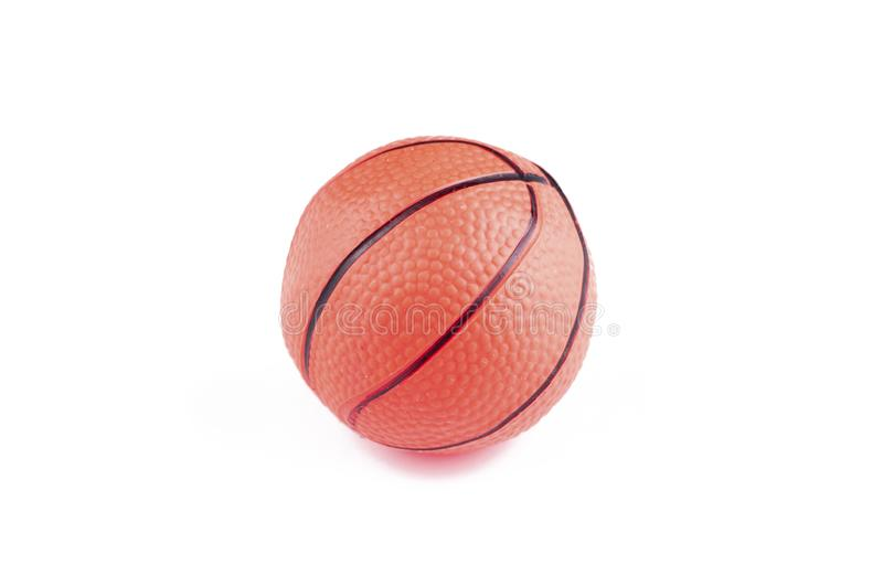 Children's basketball ball isolated on a white background.Copy space. Play textured rubber closeup object game sphere orange sport studio symbol stock photography