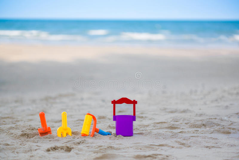 Children`s beach toys - buckets, spade and shovel on sand on a s royalty free stock photo