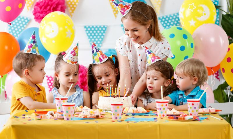 Children`s birthday. happy kids with cake stock photos