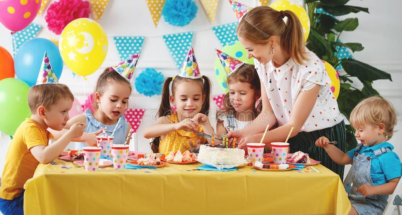 Children`s birthday. happy kids with cake royalty free stock photos
