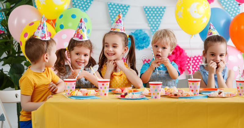 Children`s birthday. happy kids with cake royalty free stock photo