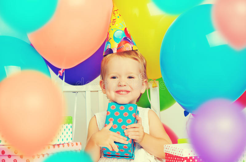 Children's birthday. happy little girl with gifts. And balloons stock photos