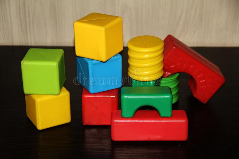 Children`s bright cubes of different shapes stock photos