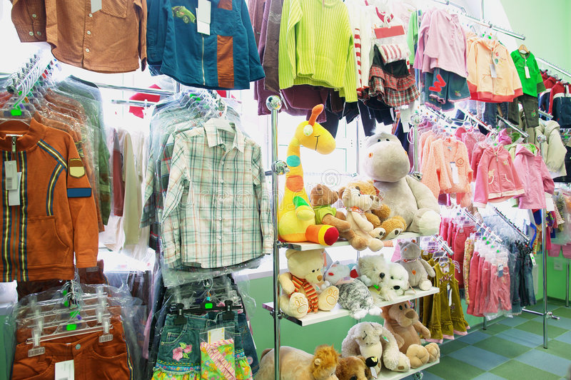 Children's clothes and toys royalty free stock photo
