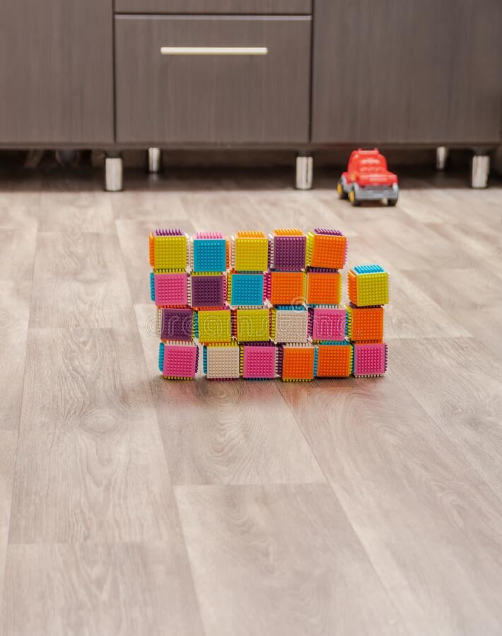 Children`s colored cubes on the floor stock photos