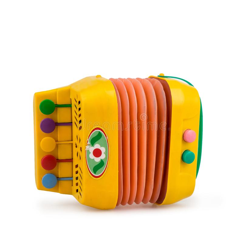 Children`s colorful toy accordion on a white background. Isolated side view stock illustration