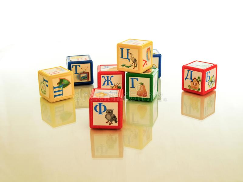 Children`s cubes - educational and educational game, teaches the child grammar and develops motor skills. Children`s cubes, a wonderful educational toy for the royalty free stock photos