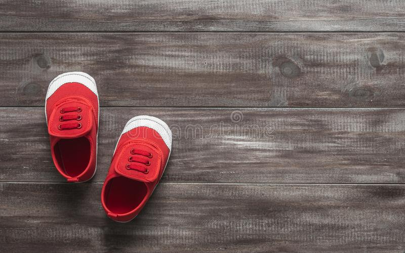 Children`s cute red small sized canvas shoes top view overhead s stock photography