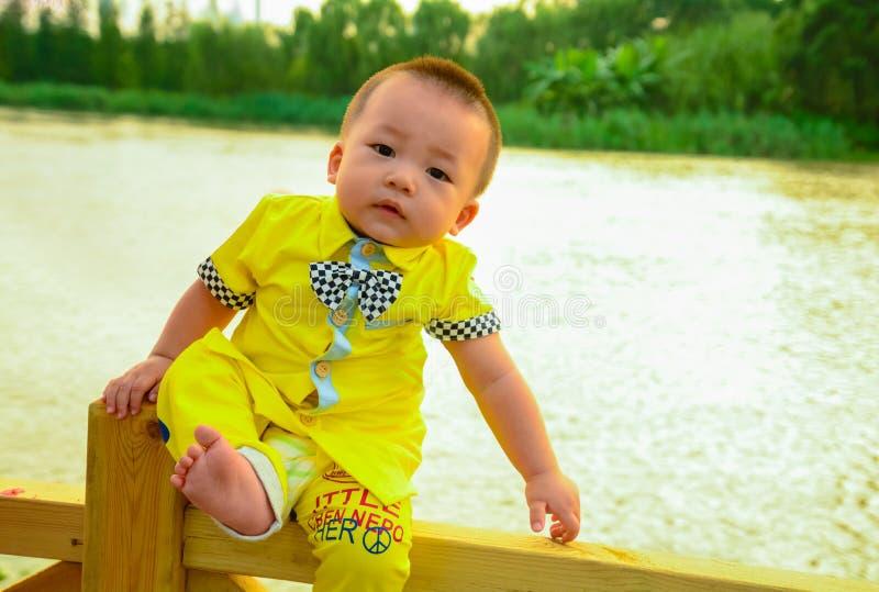 Children's dangerous climb royalty free stock images