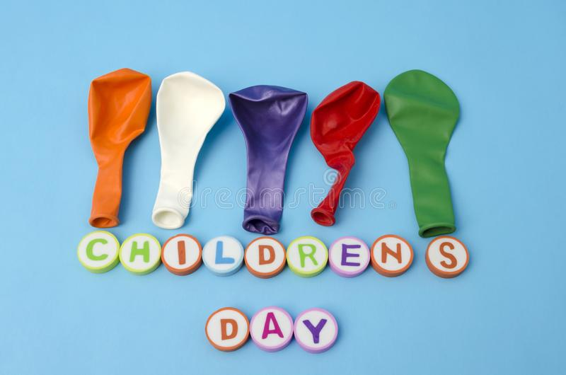 Children`s Day made from colorful letters and colorful deflate ballons royalty free stock photo