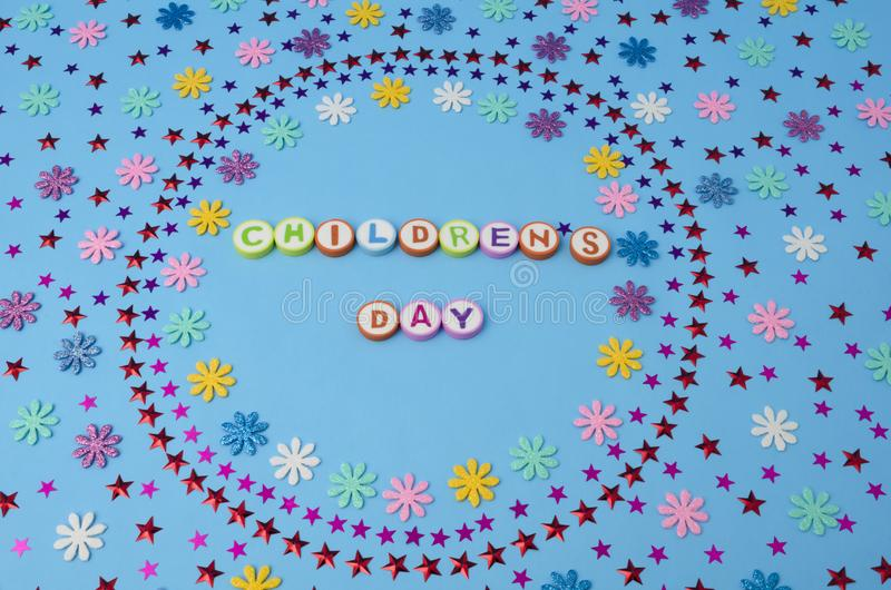 Children`s Day made from colorful letters and flowers and stars confetti stock photo