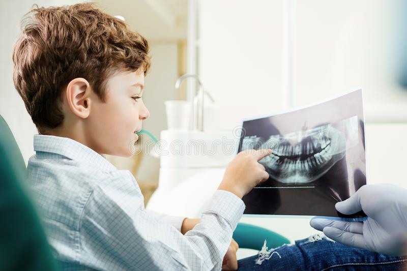 Children`s dentistry. A child in the dental office.  stock photos