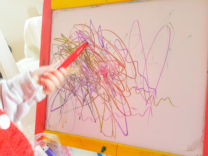 Children `s drawing abstract lines preschool age stock photo