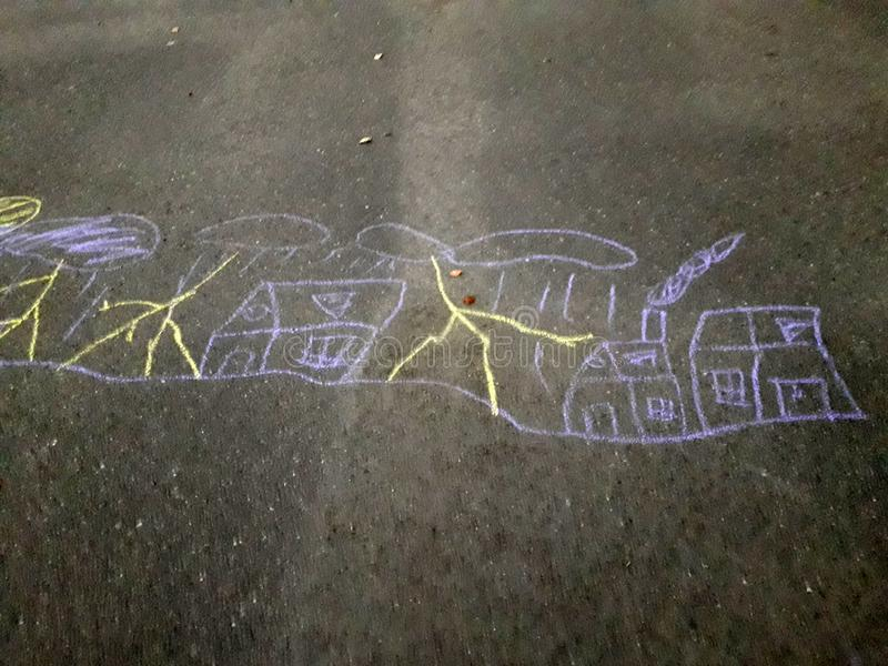 Children`s drawing on the asphalt with chalk. On the picture we see the city, over which the rain and the thunder and lightning. stock illustration
