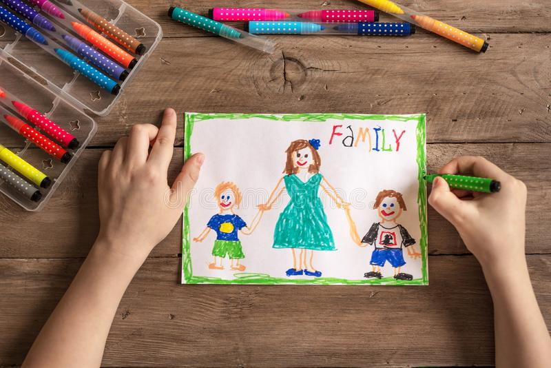 Incomplete family drawing. Children`s drawing of family single mom and two sons. Incomplete family concept royalty free stock photos