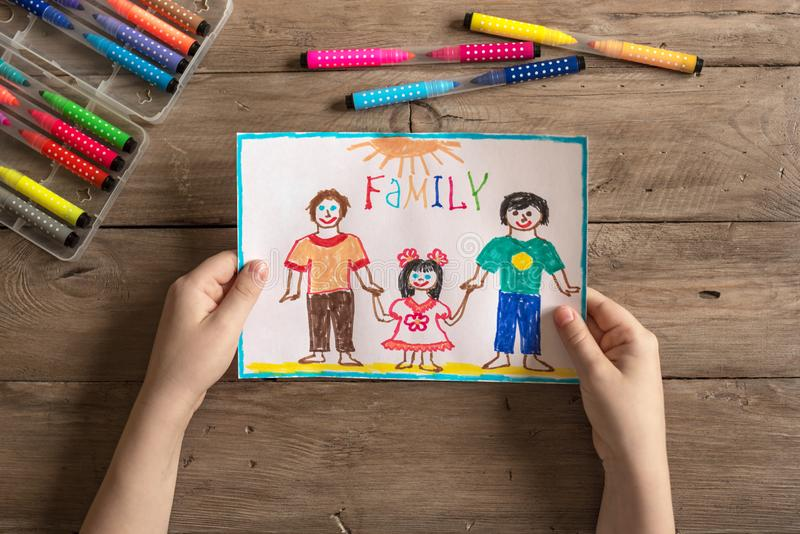 LGBT family drawing. Children`s drawing of LGBT family two dads and daughter. Same-sex homosexual family concept stock photo